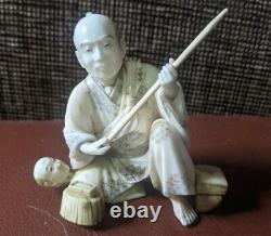 Meiji Netsuke okimono of a man with a spear superb detail signed by carver